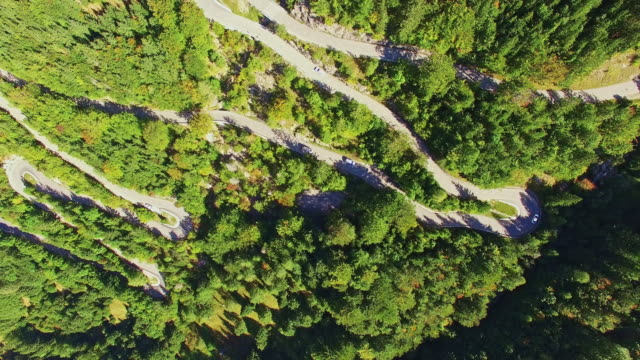 aerial vehicles crossing a mountain pass - julian alps stock videos and b-roll footage