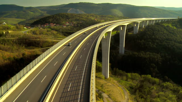 vehicles crossing a viaduct - motorway stock videos & royalty-free footage