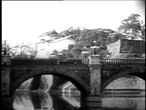 Vehicles crossing arched bridge / Tokyo Honshu Japan