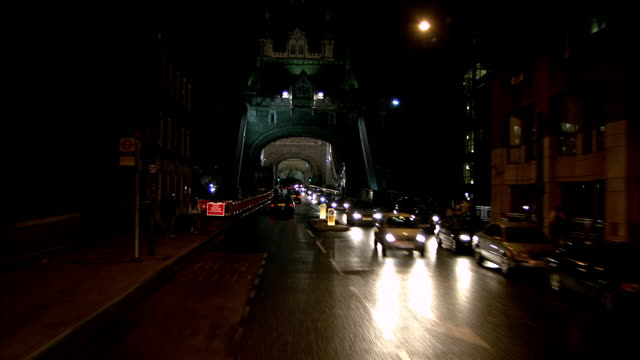 WS POV Vehicles crossing Tower Bridge at night / City of London, London, England