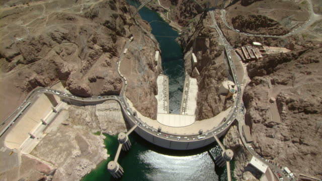 vehicles drive across the hoover dam. - hoover dam stock videos and b-roll footage