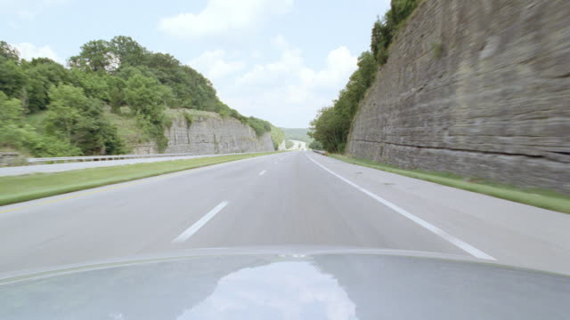 vehicles drive along a highway. - surrounding wall stock videos & royalty-free footage