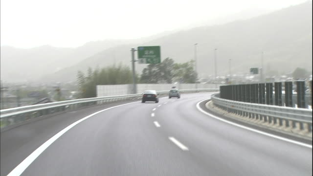 Vehicles drive around a curve on the Kita-Kanto Expressway in Tochigi Prefecture, Japan.