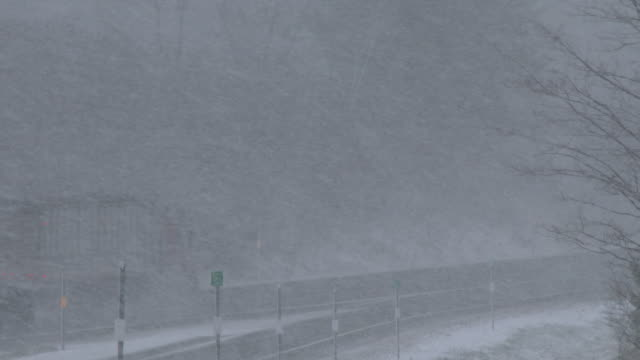 Vehicles drive in near whiteout conditions on Interstate 81 near Pulaski NY as heavy lake effect snow falls