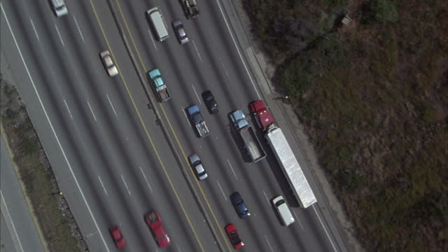 Vehicles drive on a major highway near Los Angeles.