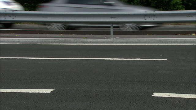 Vehicles drive over surface of motorway, UK