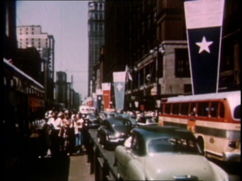 1951 ws vehicles driving and people walking on crowded detroit street / michigan, united states - 1951 stock videos & royalty-free footage
