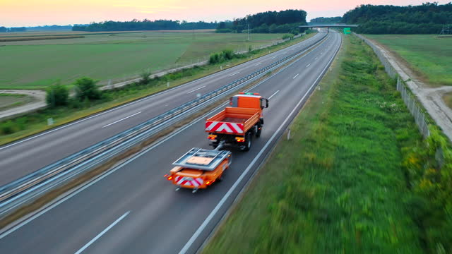 aerial vehicles driving on the highway in the countryside - 30 seconds or greater stock videos & royalty-free footage