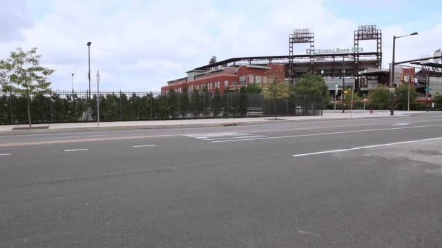 ws vehicles driving past the front of the citizens bank park / philadelphia, pennsylvania, united states - baseball diamond stock videos & royalty-free footage