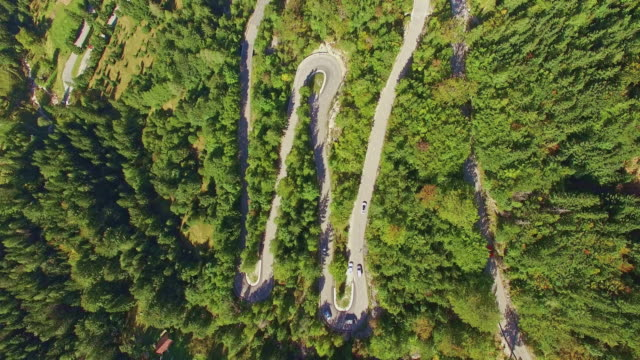 aerial vehicles driving up a winding mountain pass - julian alps stock videos and b-roll footage