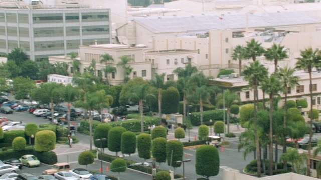 vehicles fill the parking lot of the sprawling  studio lot of hollywood's paramount pictures. - paramount pictures stock videos & royalty-free footage