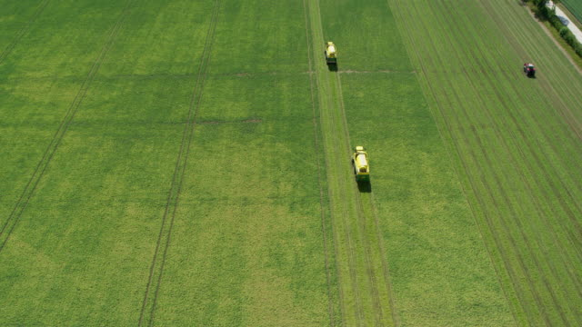 Vehicles Harvesting Peas, West Lutton, North Yorkshire, England