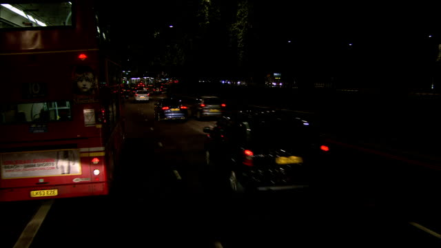 ws pov vehicles in london traffic at night on park lane / mayfair, london, england - car point of view stock videos & royalty-free footage