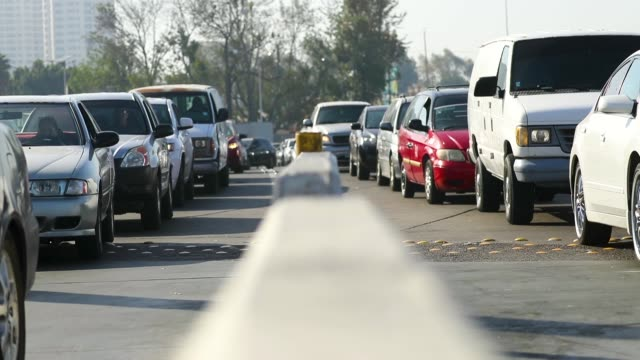 vehicles line up entering the united states at the san ysidro port of entry on april 9 2018 in san ysidro california - zoll und einwanderungskontrolle stock-videos und b-roll-filmmaterial