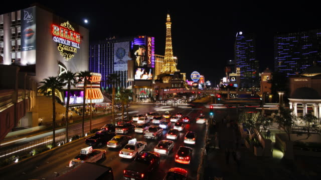 vehicles move past casinos on the las vegas strip. - las vegas replica eiffel tower stock videos and b-roll footage