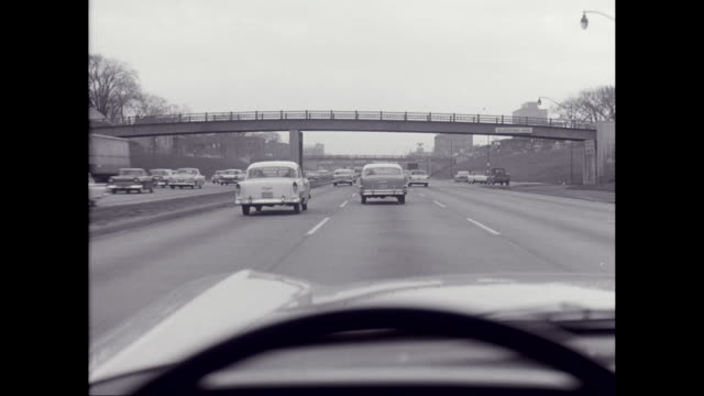 ws pov vehicles moving on highway in detroit / united states - black and white stock videos & royalty-free footage