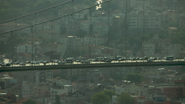 vehicles on bosphorus bridge in istanbul - ponte video stock e b–roll