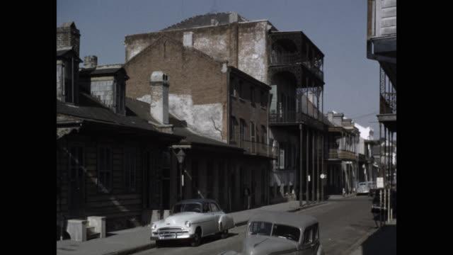 vehicles on street in city, new orleans, louisiana, usa - louisiana stock videos & royalty-free footage