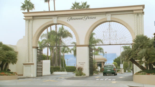 vehicles pass by the melrose gate at hollywood's paramount studios. - paramount pictures stock videos & royalty-free footage