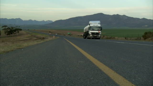 Vehicles pass each other on a rural road.