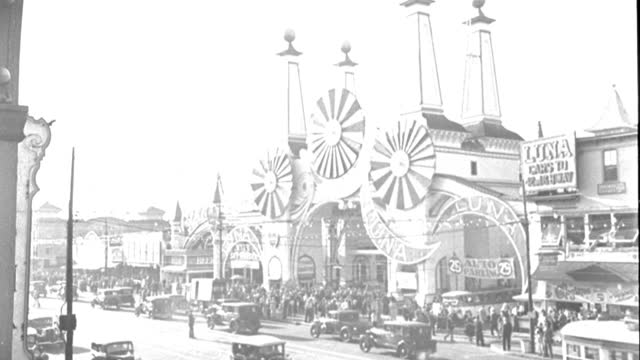vehicles pass near the entrance to luna park at coney island in brooklyn, new york, in 1934. - 1934 stock videos & royalty-free footage