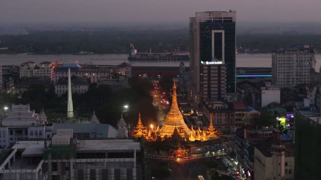 Vehicles pass the Sule Pagoda in Yangon Myanmar on Saturday March 11 Elevated view of congested traffic on a road at dusk Elevated view of cars on a...