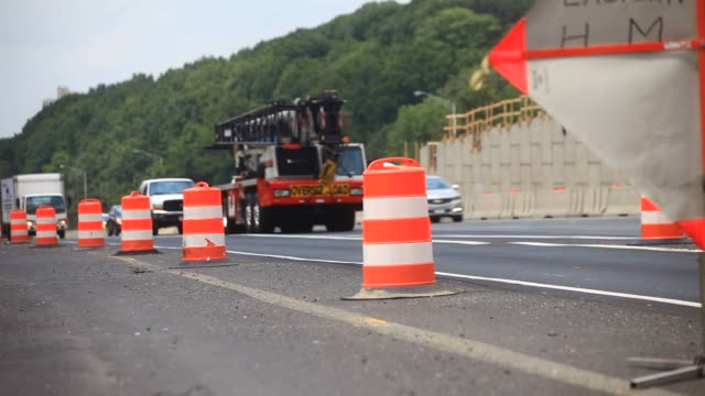 Vehicles pass traffic barrels on the Seminary Road overpass above Interstate 395 during a Virginia Department of Transportation project in Alexandria...