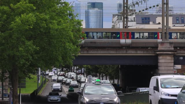 vehicles pass under a railway bridge at rush hour on seine river banks on june 18, 2020 in asnieres sur seine, france - suburban stock videos & royalty-free footage