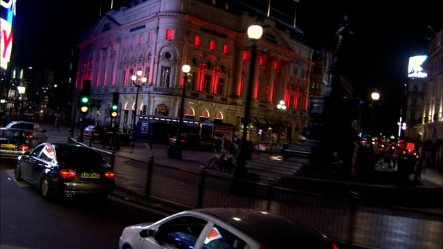ws pov vehicles passing through piccadily circus at night / piccadily, london, england - car point of view stock videos & royalty-free footage