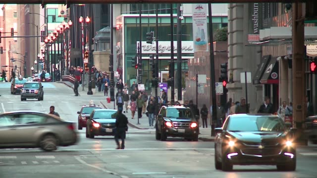 wgn vehicles people and buildings in chicago's loop area on may 15 2017 - chicago loop stock videos and b-roll footage