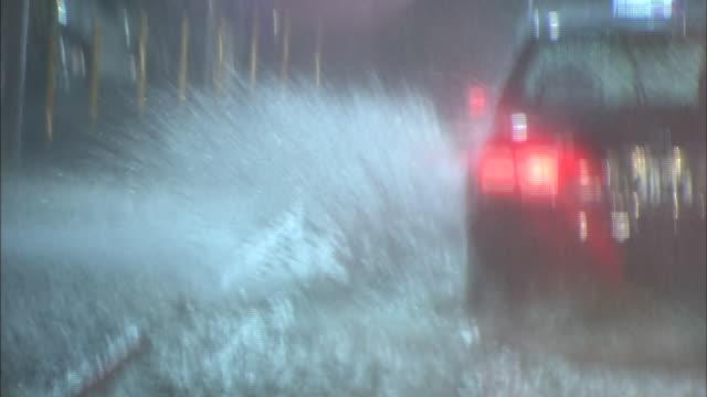 Vehicles run through the overflood street in the heavy rain/Shot at the Ikeda City in Osaka on September 112014