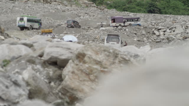 nepal - august 1, 2015: vehicles struggle over road after landslide - rural scene stock videos & royalty-free footage