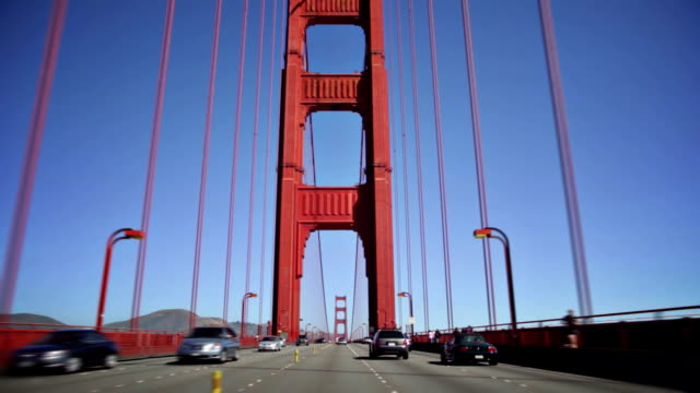 vehicles travel across the golden gate bridge. - golden gate bridge stock videos & royalty-free footage