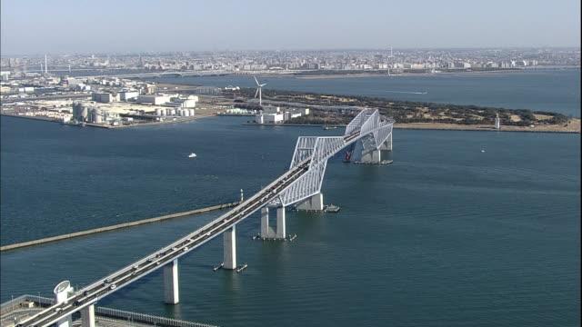 vehicles travel across the tokyo bay in both directions as the tokyo gate bridge opens. - kantilever bildbanksvideor och videomaterial från bakom kulisserna