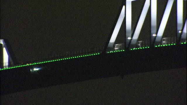 vehicles travel high above tokyo bay on the tokyo gate bridge. - intoning bildbanksvideor och videomaterial från bakom kulisserna