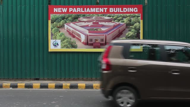 vehicles travel past the construction site for the new parliament building, part of the central vista project redevelopment project, on january 8,... - parliament building stock videos & royalty-free footage