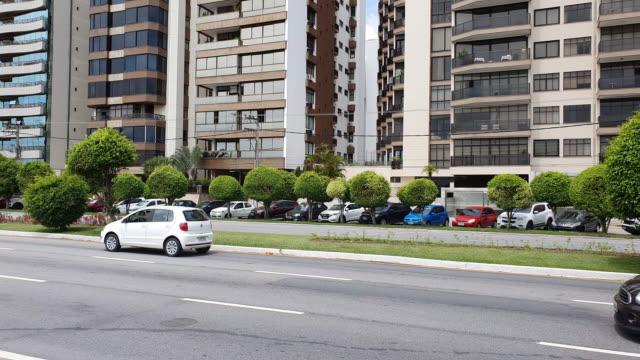 vehicles traveling along avenida beira mar in florianopolis - avenida stock videos & royalty-free footage