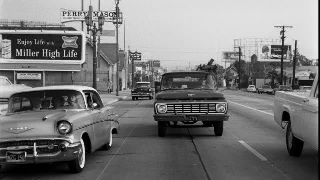 ws b/w vehicles traveling through la brea avenue / los angeles, california, usa - western script stock videos & royalty-free footage