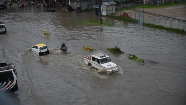 vehicles travelling through water logged road at banepa, kavrepalanchok, nepal on friday, july 12, 2019. due to the poor water drainage management... - monsoon stock videos & royalty-free footage