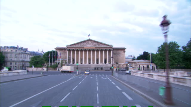 vehicles turn in front of the french national assembly building in paris. - pediment stock videos & royalty-free footage