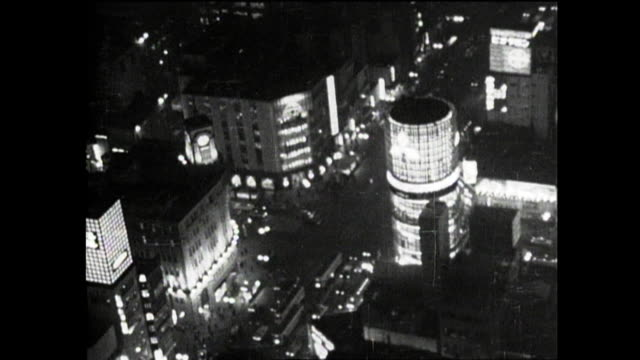 vehicular traffic moves through ginza's 4-chome intersection. - 1964 stock videos and b-roll footage