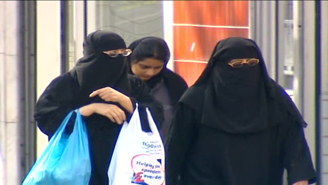 veil row over muslim teacher aisah azmi escalates date muslim women along street wearing black niqab veils and gowns end lib - 女性教師点の映像素材/bロール