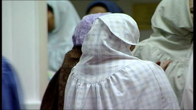 veil row over muslim teacher aisah azmi escalates date muslim woman wearing full burqa veil towards muslim women wearing veils - 女性教師点の映像素材/bロール