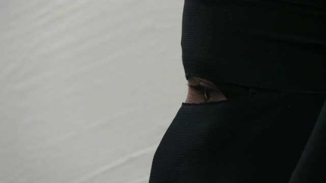 A veiled Bedouin woman in the Negev desert Israel