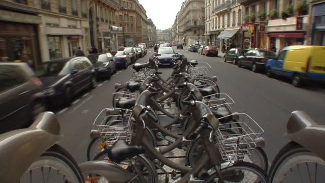 REAR POV Velib bikes on truck traveling through city, Paris, France