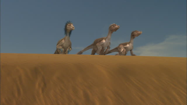 CGI, MS, PAN, Velociraptors attacking dinosaur on sand dune