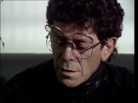 velvet underground reform; cms lou reed intvwd sot - on meeting up at paris warhol exhibition and playing impromptu set / then meeting up again - ルー リード点の映像素材/bロール