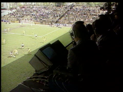 venables loses legal case bv brian moore football match bv camera taking pictures of match - sports commentator stock videos & royalty-free footage