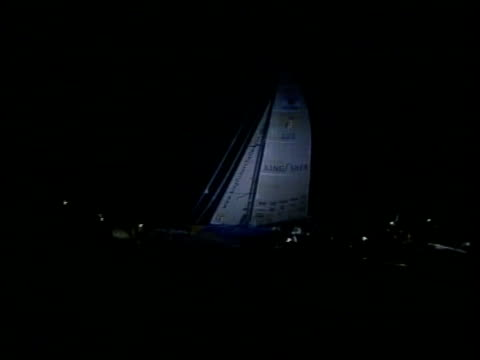 macarthur finishes itn view 'kingfisher' yacht of ellen macarthur illuminated by spotlight along with small boats around as approaching finish of... - itv late evening bulletin stock videos and b-roll footage