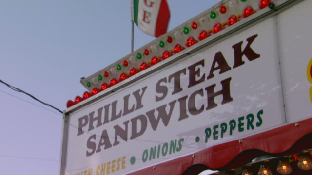 Vender signs for Sausage and Philly Steak Sandwich